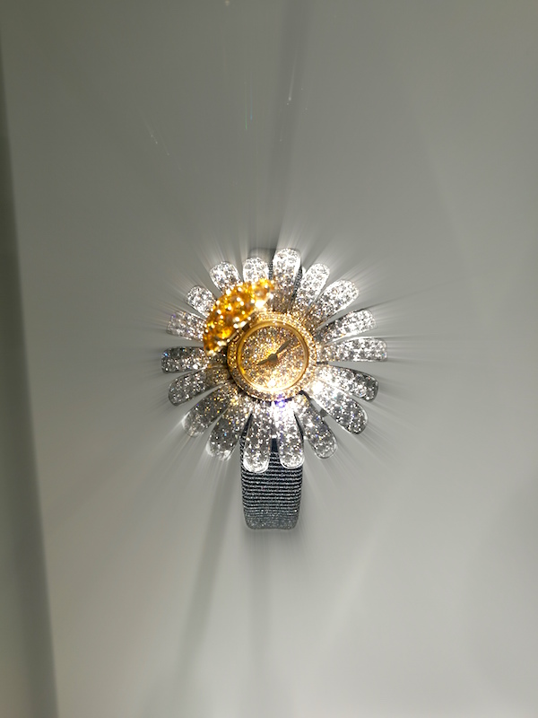 The beautiful diamond flower watch with Yellow diamond centre. Marguerite Secrète watch from SIHH 2018