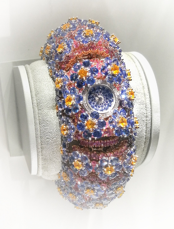 The Forget Me Not watch from SIHH 2018. Myosotis watch with just 12mm diameter dial in white gold, round blue sapphires.